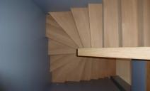 vue de dessus escalier béton habillé chêne